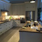 Contemporary Kitchen Cabinets with lighting by Zsibi